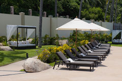 Sun loungers and parasols. Row of sun loungers under parasols, summer scene royalty free stock photo