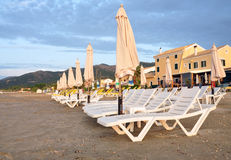 Sun loungers and parasols on the beach Royalty Free Stock Photography