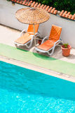 Sun loungers and parasols Stock Image