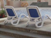Sun loungers by the pool. On the Pearl island in Doha, Qatar royalty free stock image