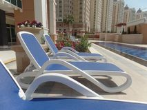 Sun loungers by the pool. On the Pearl island in Doha, Qatar stock image