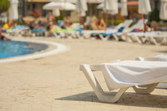 Sun loungers by the pool. Stock Photo