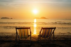 Sun loungers on the sea beach during amazing sunsetÑŽ Relax. Sun loungers on the sea beach during amazing sunset royalty free stock photos