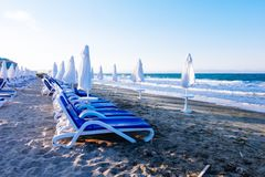 Sun loungers by the sea on the beach. Concept vacation, resort royalty free stock photos