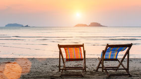 Sun loungers on the sea beach. Relax. Stock Images