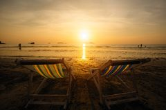 Sun loungers on the sea beach during sunset. Nature. Sun loungers on the sea beach during sunset royalty free stock photos