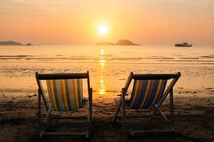 Sun loungers on the sea beach during sunset. Relax. Sun loungers on the sea beach during sunset royalty free stock photos