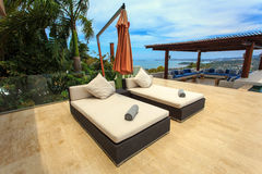 Sun loungers stand at the pool and beutiful view Royalty Free Stock Photos