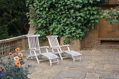 Sun loungers on stone patio Royalty Free Stock Photos