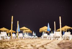 Sun loungers. Sun loungers on the beach at night Stock Photography