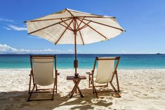 Sun loungers. On the white sand beach in front of the lagoon stock images