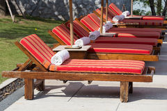 Sun loungers with towels near the swimming pool Royalty Free Stock Image