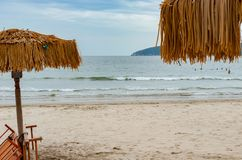 Sun loungers and umbrell. On a beach royalty free stock photography