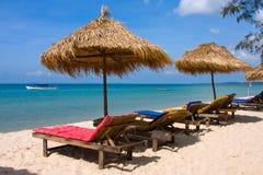 Sun loungers with an umbrella stock photo