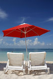 Sun Loungers and Umbrella Stock Photo