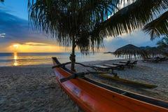 Sun loungers with umbrella on the beach, sunrise.  stock photos
