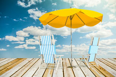 Sun loungers and umbrella Stock Photos