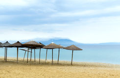 Sun loungers with an umbrella morning on the beach Stock Image