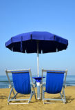 Sun loungers and umbrella Royalty Free Stock Images