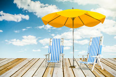 Sun loungers and umbrella. Two sun loungers and umbrella royalty free stock photo
