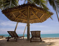 Sun loungers and  Umbrellas against  blue sea at sun day Mui Ne Stock Photography
