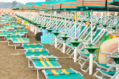 Sun loungers. And umbrellas on a beach Royalty Free Stock Photo