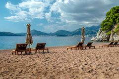 Sun loungers and umbrellas. Are on the beach stock image