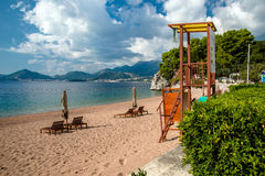 Sun loungers and umbrellas. Are on the beach royalty free stock image
