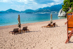 Sun loungers and umbrellas. Are on the beach royalty free stock photos