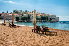 Sun loungers and umbrellas Stock Photography