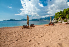 Sun loungers and umbrellas. Are on the beach stock photo