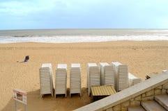Albufeira beach sun loungers on the beach. Sun loungers waiting for hire on Albufeira beach stock photo
