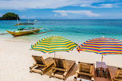 Sun lounges with umbrellas at Ilig Iligan Beach, Boracay Island, Philippines. Sun lounges at Ilig-Iligan Beach, Boracay Island, Philippines stock image
