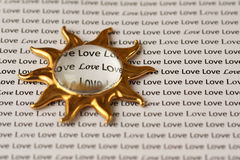 Sun and Love. Golden sun on the text Stock Image