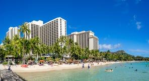 Sun lovers on Waikiki beach Royalty Free Stock Photography
