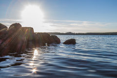 Sun lowering behind boulders Royalty Free Stock Photography