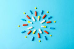 Free Sun Made Of Pills On Blue Background, Top View Royalty Free Stock Photos - 165941588