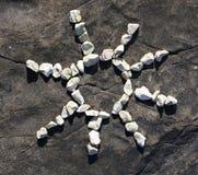 Sun made of pebbles Stock Photos