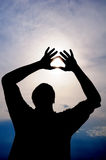 Sun in male hands stock photography