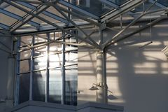 The sun in metal constructions. Of a glass roof royalty free stock images