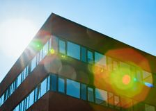 Sun at Modern corporate business office building skyscraper. Concept stock image