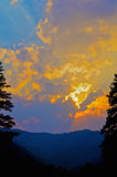 Sun Montana Rockies aumentante Immagine Stock