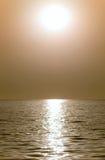 Sun or moon. Above the waves of the sea or ocean stock photos
