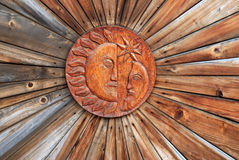 Sun and Moon. In wood sculpture royalty free stock photo