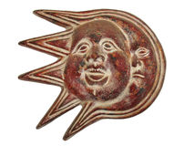 The Sun and the Moon. Terracota representing the Sun and the Moon faces together stock photography