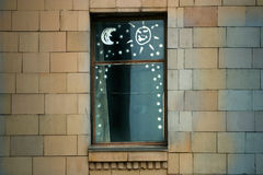 Sun and moon. Window with children's figure on glass stock photo
