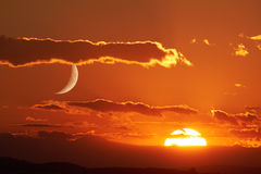 Sun and Moon. The sun and the moon can be seen simultaneously in the sky royalty free stock photo
