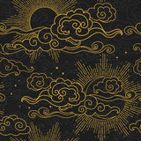 Sun and moon in cloudy sky. Golden silhouettes on black background. Vector hand drawn seamless pattern in oriental style Stock Photo