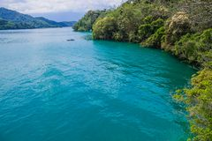 Sun moon lake. The beauty of the Sun Moon Lake is the calm, turquoise water complemented by the majestic mountains that surround the lake royalty free stock photo