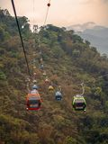 The Sun Moon Lake Rope way, a scenic gondola colorful cable car, moving through mountains. royalty free stock photo